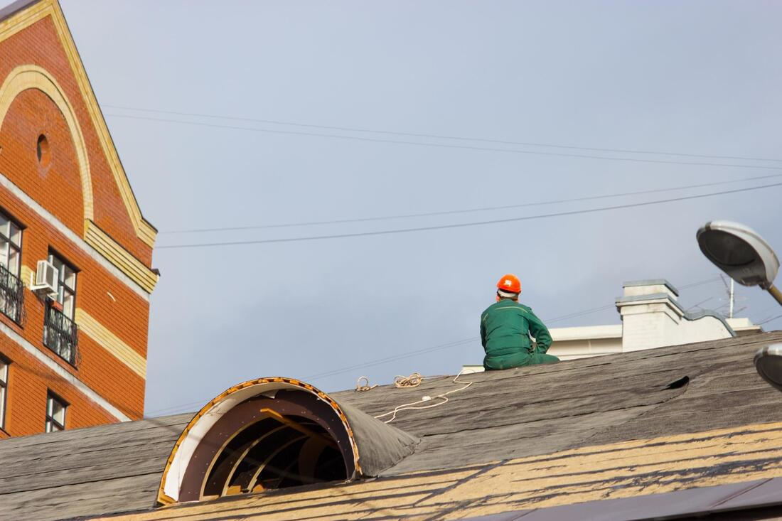 professional roofer working on commercial roofing